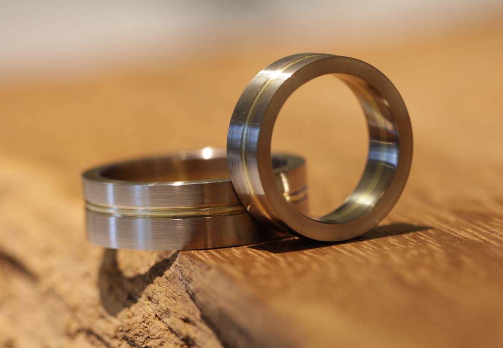 Image 001: solid two-tone wedding rings made of gray and yellow gold.