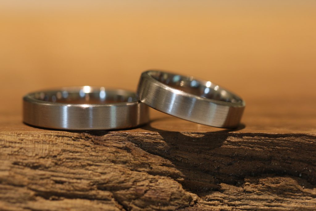 Image 004: Wedding rings for eternity, timeless and simple, gray gold, matt surface.