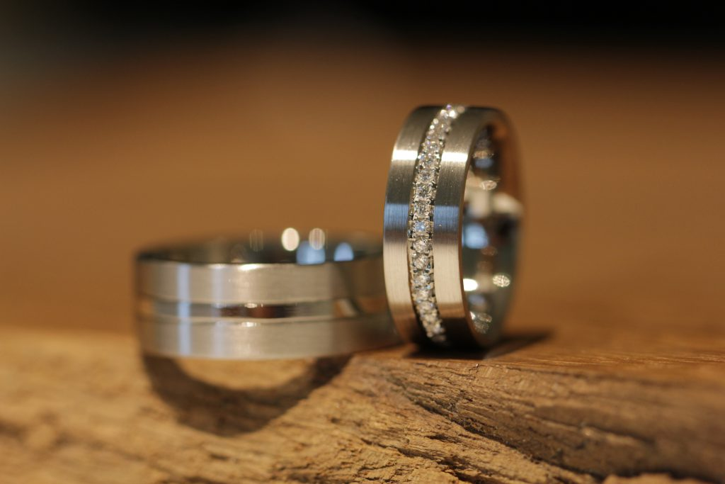 Image 022b: Platinum wedding rings, wedding ring for you polished with diamonds in thread setting, wedding ring for him matt with center line glossy.