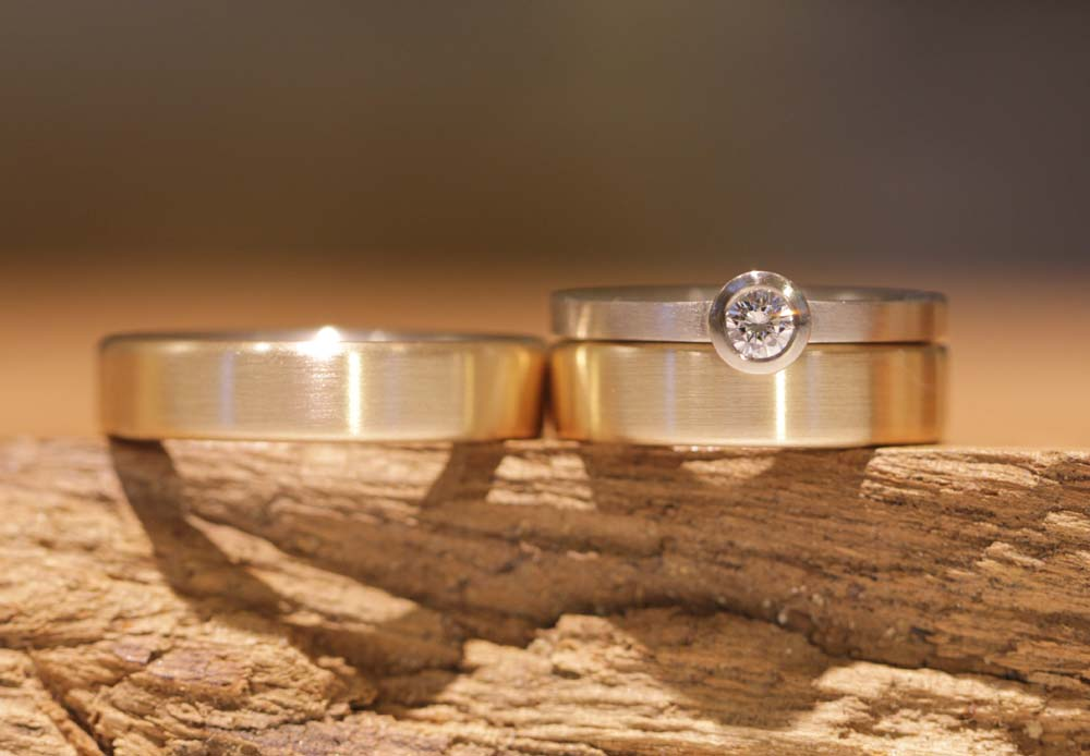 Image 034a: Design adapted, wedding rings with matching engagement ring.