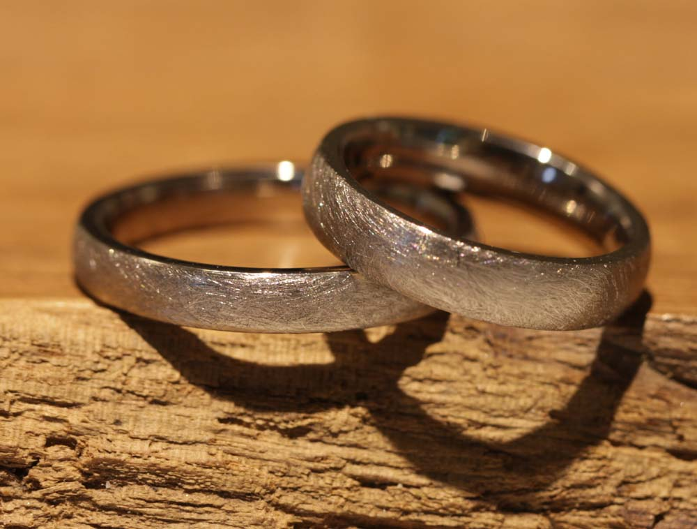 Image 036b: handmade vintage wedding rings made of gray gold.