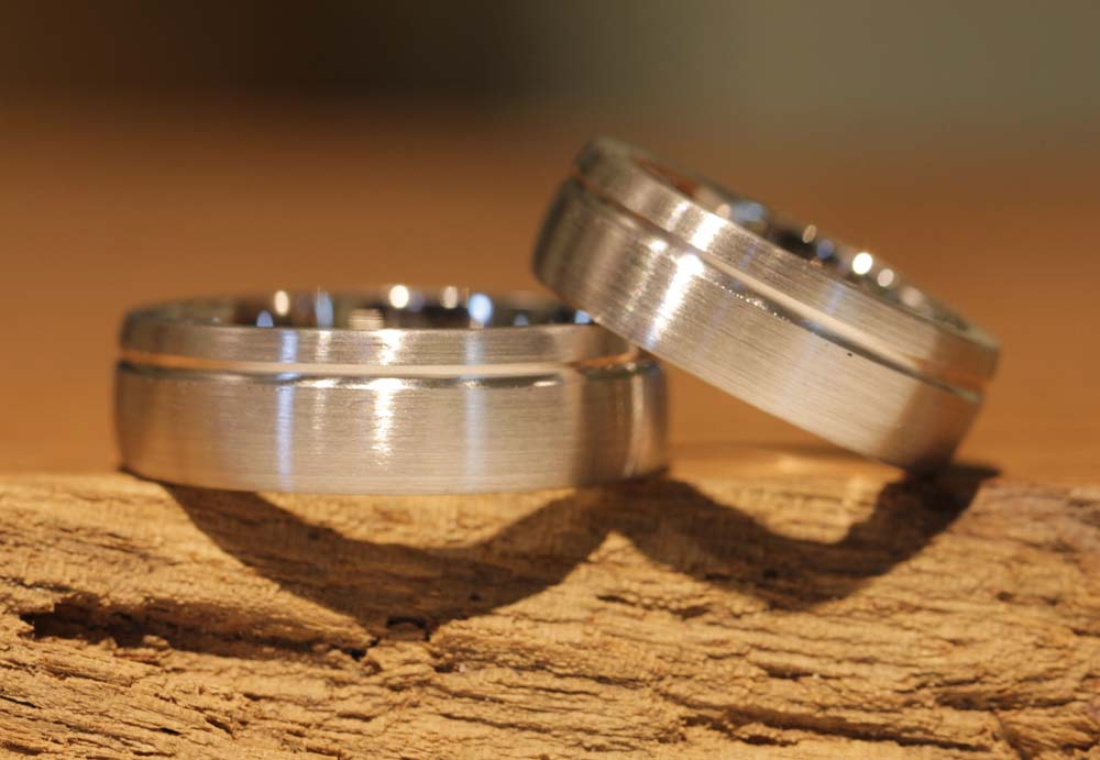 Image 38a: wide wedding rings with clear lines, two-tone.