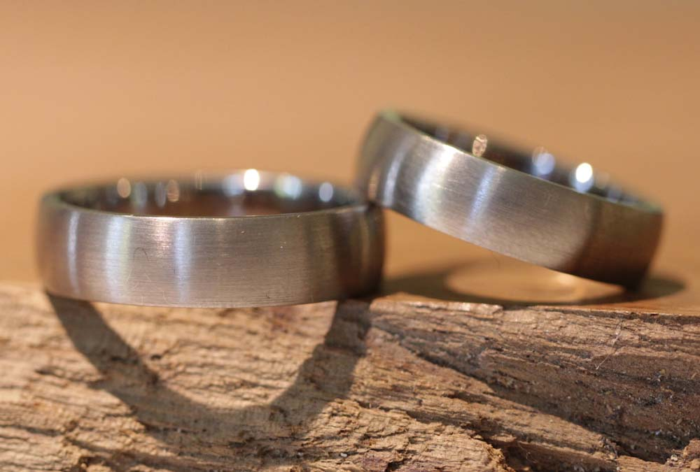 Image 041: wide wedding rings for men, without stone, gray gold matt.