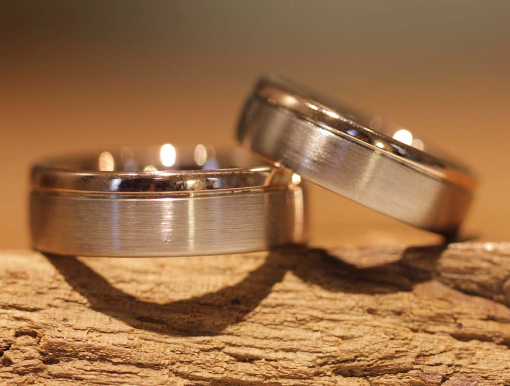Image 46b: two-tone, modern wedding rings with milled edge.