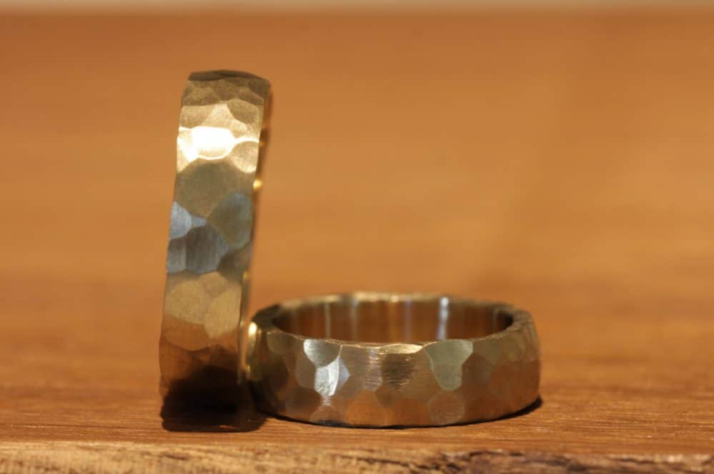 Image 048a: hammered look, hand-forged old school wedding rings, yellow gold.