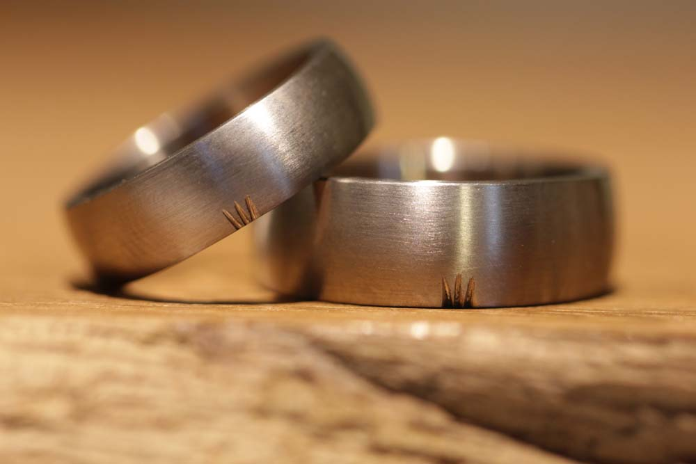 Image 052: individual wedding rings with personal symbol in gray gold, matt.