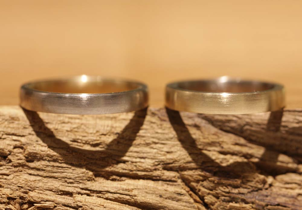 Image 054: wedding rings, narrow and two-tone, inside out.