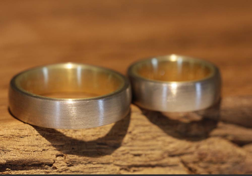 Image 069b: bicolour wedding rings, thick, white gold outside, yellow gold inside.