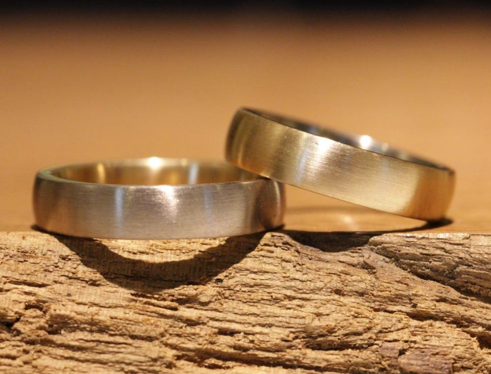 Image 157b: Wedding rings, different, made of gray and rose gold using the soldering technique.