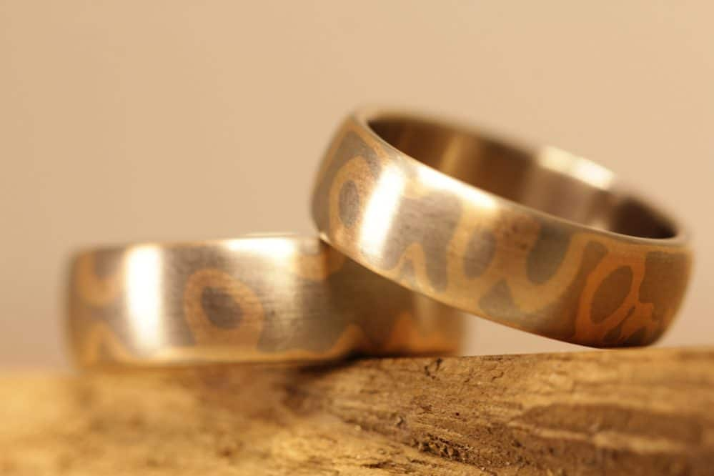 Image 170a: Mokume Gane wedding rings made of gray gold and red gold, Japanese blacksmithing.
