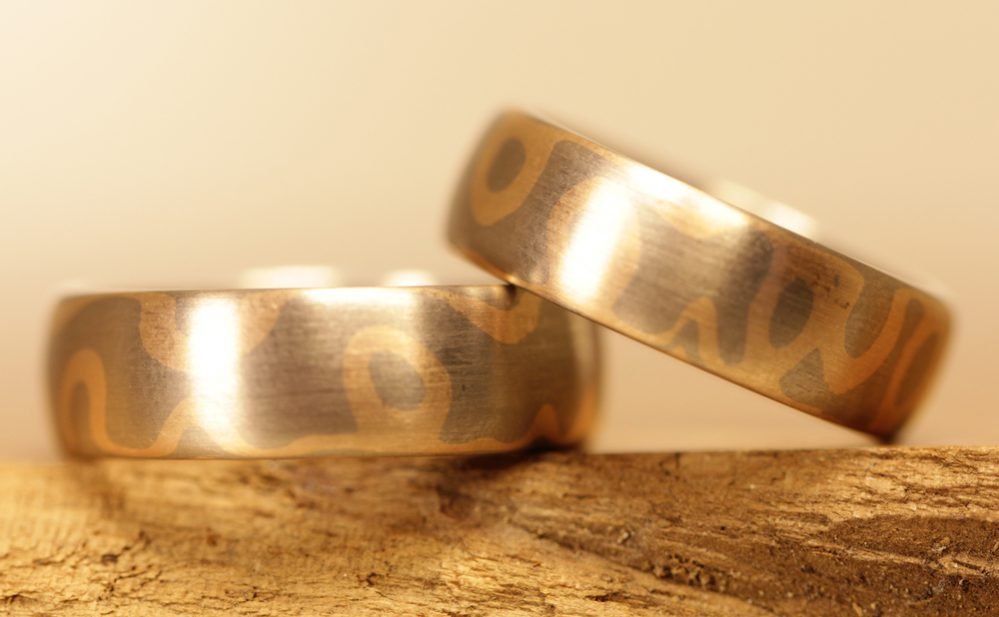 Image 170b: wide, multi-colored wedding rings made using the Mokume Gane technique.