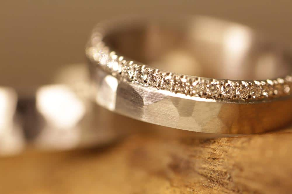 Image 177: Wedding rings forged from platinum, diamonds in a thread setting.