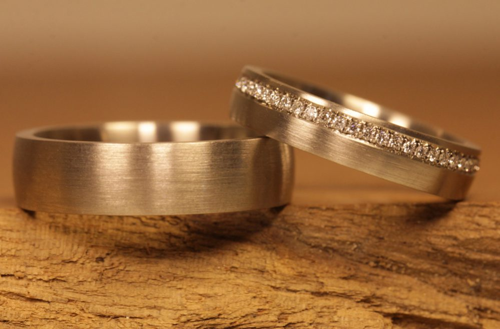 Image 182a: Wedding rings made of gray gold, diamonds, thread setting.
