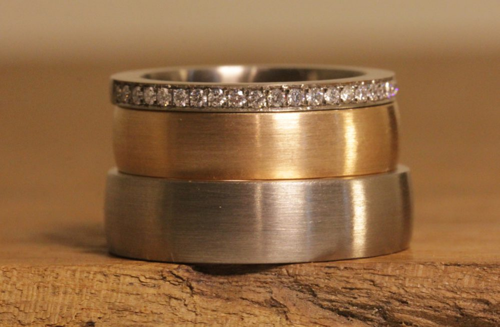 Image 186a: classic wedding rings in two colors with stacking ring, plug-in soldering technique.