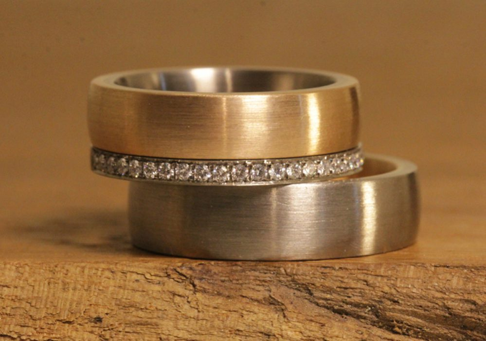 Image 186c: wide wedding rings, multi-colored, matt surface, bezel ring.