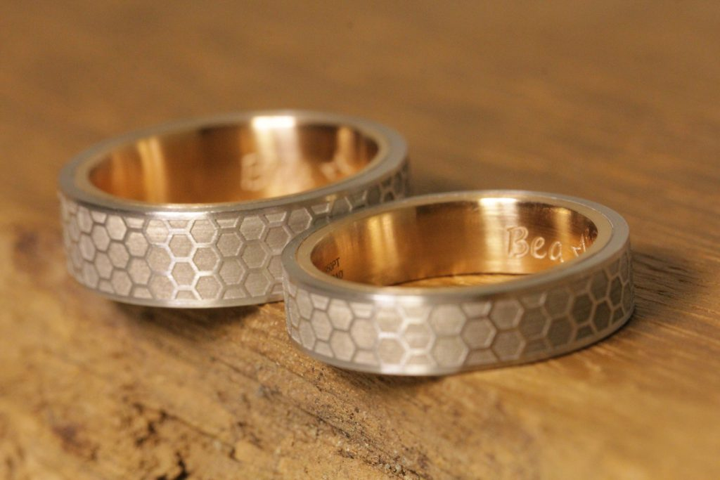 Image 188a: Two-tone wedding rings with individual laser engraving.