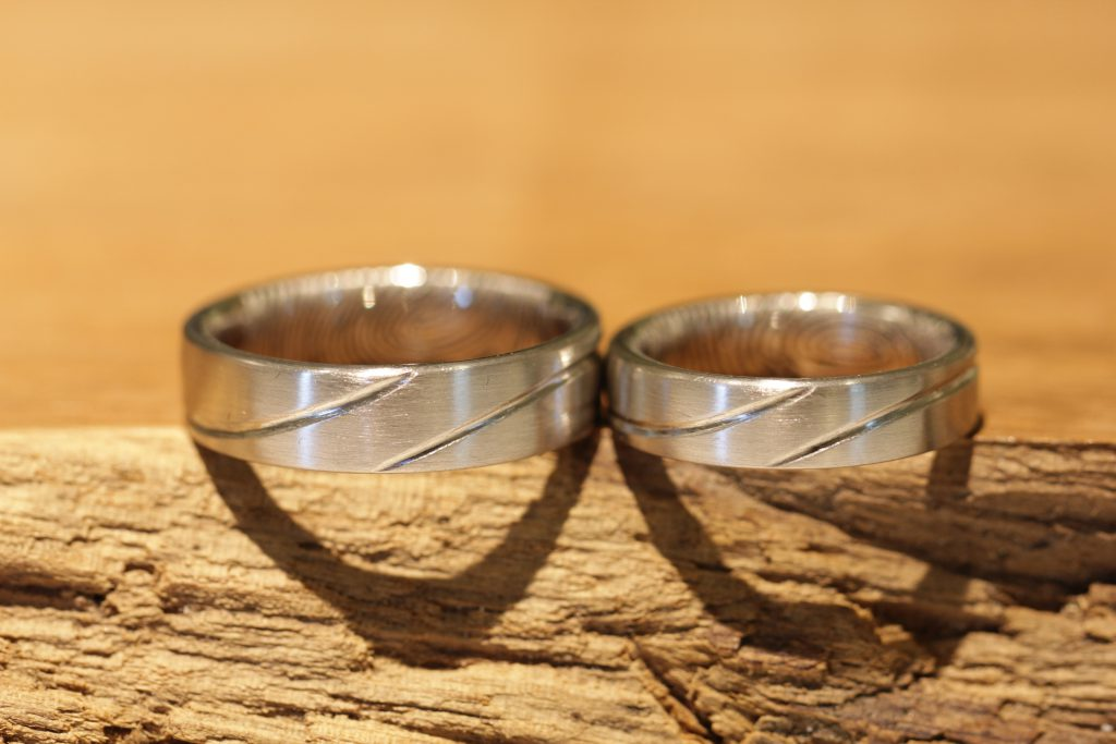 Image 193a: wedding rings made of white gold with lines, matt.